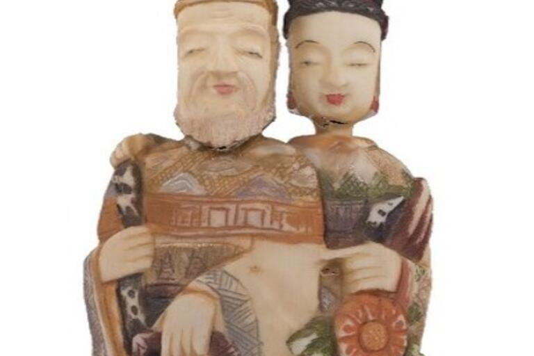 Snuff bottle, stained and carved ivory, represents Chinese couple.