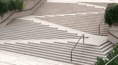 Innovative outdoor staircase showing a mix of ramps, steps, and railed areas